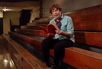 Sister Mary reminisces over a playbill from her teaching days.