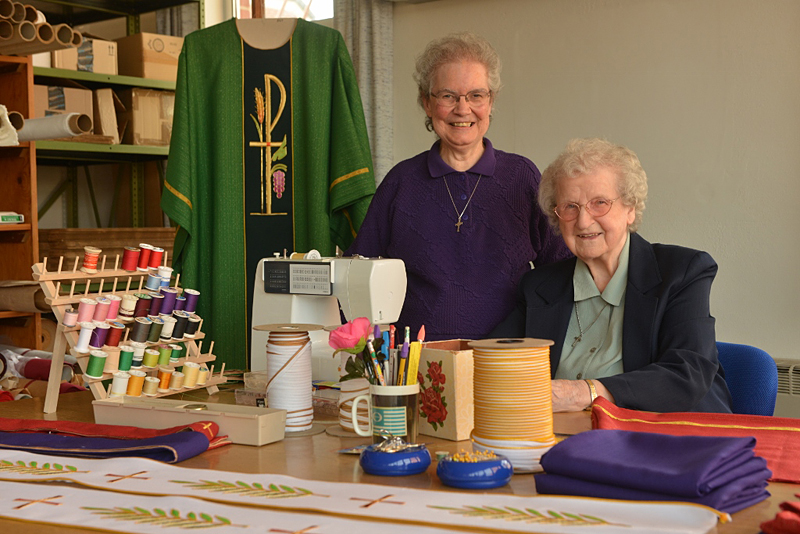 Precious Blood Sisters Viola Marie Spire (left), 82, and Ann Hipp, 95, sew altar cloths and vestments in their community's Ecclesiastical Art Department. Sister Ann is featured on the 2015 Retirement Fund for Religious campaign materials.