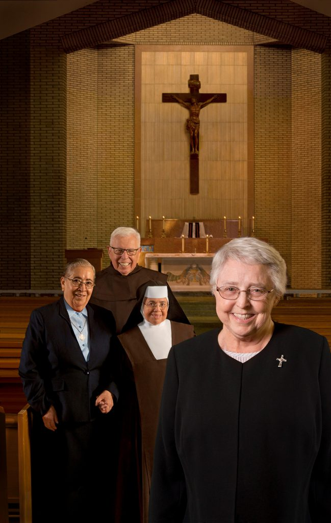 Four religous members in a chapel