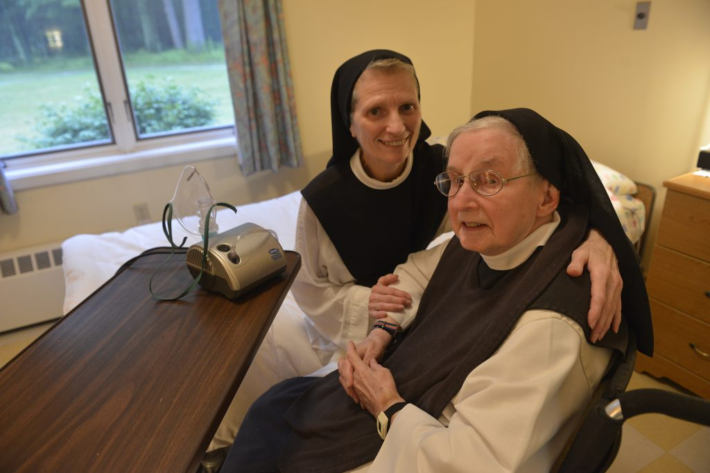 Two Nuns at a desk